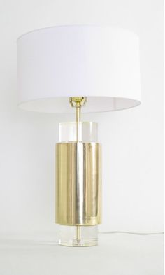 """Modern Allure Table Lamp, Large •Lucite and brass lamp. •UL approved. •Maximum bulb wattage is 60 watts. •To clean, polish with a soft cloth. •5"""" diameter x 25"""" tall (with shade) #maindecor #modernlighting #modernlamp #homedecor #lighting #tablelamp"""