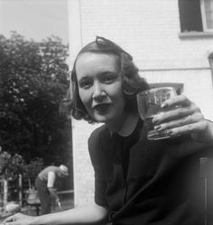 'Photograph of Mary Oliver raising a glass at her home, Pembroke Lodge, Richmond', Eileen Agar [1930s] - part of the digitised collection of the Tate Archive