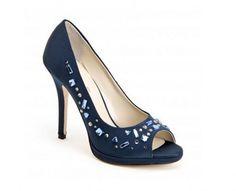 collezione-scarpe-e-scarpe-primavera-estate-2013-decollete-estrada-borchie