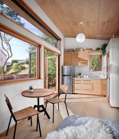 This efficient tiny house from San Francisco's AVAVA Systems, engineers simple yet beautiful buildings for the future. Love the window and flooring in this tiny kitchen. | Tiny Homes