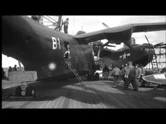 A PBM-5 Mariner is hoisted off the deck of USS Henderson and lowered into water o...HD Stock Footage - YouTube ~ BFD