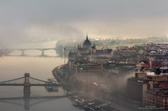 """archatlas: """" Foggy Budapest by Tamás Rizsavi Tamás Rizsavi is a Hungarian urban photographer that spent 4 years capturing the beauty of Budapest when It's covered by fog. It is pretty rare in Budapest when the fog sits so low that the bridges and. Most Beautiful Cities, Wonderful Places, Travel Pictures, Travel Photos, Capital Of Hungary, Travel Around Europe, Great Shots, Tower Bridge, Mists"""