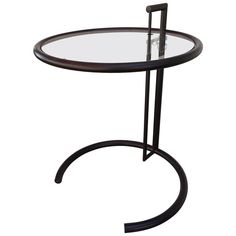 Eileen Gray Black Steel Adjustable End Table | From a unique collection of antique and modern end tables at https://www.1stdibs.com/furniture/tables/end-tables/