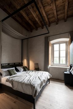 Each bedroom occupies what would have been two monastery cells, with a larger suite occupying the former washroom. Suspended Bed, Ribbed Vault, Roof Beam, Spa Rooms, Interior Architecture, Interior Design, Oak Panels, Relaxation Room, Iron Furniture