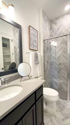 Herringbone Shower Tile Design Beautiful bath with dark cabinetry and herringbone tile pattern in th Shower Tile Designs, Walk In Shower Designs, Toilet Tiles Design, Toilet And Bathroom Design, Diy Bathroom Remodel, Bathroom Renovations, Budget Bathroom, Dyi Bathroom, Shower Remodel