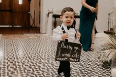 Cute Sign for Page Boy at Wedding | By Through The Glass | Monochrome Wedding | White Wedding Flowers | LA Wedding | Luxe Wedding | Made With Love Bridal | First Look | Black and White Wedding Decor | Monochrome Colour Scheme for Wedding | Black and White Colour Scheme for Wedding | Black Tie Wedding | Wedding Sign | Kids at Wedding | Funny Wedding Sign