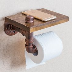 Bathroom Shelf Toilet Paper Roll HolderBring a touch of rustic-style industrial flair to your bathroom decor with this useful bathroom shelf and toilet paper holder.Use in the bathroom to not only store items but also to hold and display toilet paper. Wood Storage Shelves, Pipe Shelves, Wooden Shelves, Paper Storage, Storage Rack, Wall Storage, Garage Storage, Diy Storage, Storage Organization