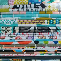 A lovely stack of tea towels all ready to be sewn by Penny Candy Handmade.