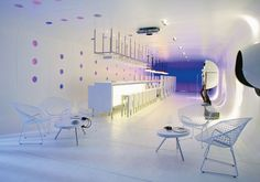 Here's an amazing modern bar idea for your home, by a Chilian architect Felipe Assadi. This bar design boasts unusual lighting, unusual bar stools, gravel [. Design Café, Bar Interior Design, Cafe Interior, Home Office Design, House Design, Design Ideas, Modern Interior, Restaurant Design, Restaurant Bar