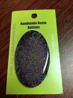 """Large Handmade Resin Button made in Montana An extremely lightweight handmade resin button, oval shaped, approximately 2 1/4"""" x 1 1/4"""" Each button is sanded by hand, then bubble coated, which makes a"""