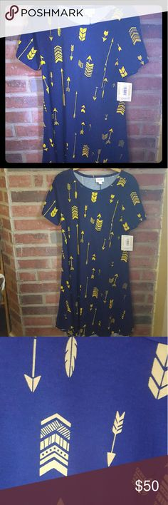 LuLaRoe Carly Dress - S - BNWT Arrows & Feathers! The Carly is a cute, comfortable swing dress that you can wear so many ways! X-Large is my normal size , but you can size down on the Carly, go with the print and length you want! I typically wear a small I the Carly and I'm a 16/18.  This features arrows and feathers, it's navy and the arrows are yellow. Super cute!  BNWT. LuLaRoe Dresses