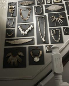 Even though this is in a home and looks like a museum display of tribal jewelry, the overall look of it would be fantastic for craft show display as well.