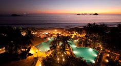 A view of the Sunscape Dorado Pacifico Ixtapa resort pool at sunset in Ixtapa, Mexico