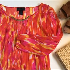 Red and Pink Sheer Blouse Beautiful sheer top in fiery red pattern. Elastic at sleeves. Like new. Tops Blouses