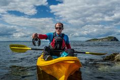 Team member Shaun using Kayaks from North Berwick kayak hire to release sponsored lobsters back into the Firth. Image copyright Edinburgh Evening News.