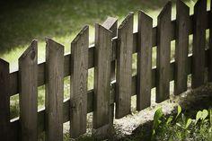 Wooden fencing around games area.