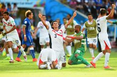 RECIFE, BRAZIL - JUNE 20: Giancarlo Gonzalez of Costa Rica celebrates with teammates after defeating Costa Rica 1-0 during the 2014 FIFA World Cup Brazil Group D match between Italy and Costa Rica at Arena Pernambuco on June 20, 2014 in Recife, Brazil. (Photo by Laurence Griffiths/Getty Images)