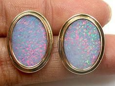 Lightning Ridge opal 18k gold earring sco957.  This unique piece of earrings is hard to find. Its rare to find 2 opals that are matching and so rare. The pinfire rainbow colors on this earrings are  absolutely beautiful.