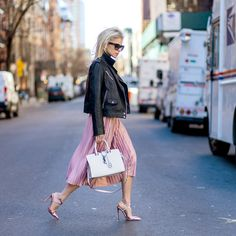 Pair a leather jacket with a pink pleated skirt and pumps to create statement street-style inspired office-wear.