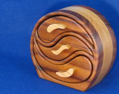 A Custom Designed Three Drawer Oval Band Saw Jewelry Box With A Hidden Drawer For Your Special Jewelry Items.l