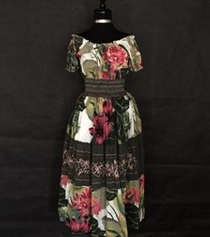 """This is a beautiful floral tone printed dress made by Signature JMB.It is a size small, made from 100% cotton, has a flattering empire waist, is long length, and has a rounded neck line.    It has the following measurements:    Length 49""""    Bust 50""""    Waist stretches from 24"""" to 50""""    Hips: Free    This item ships immediately! 📦 Also available for local try on and pick up in Sacramento, CA. 