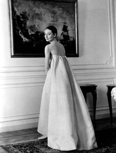 Audrey Hepburn models an empire waist dress designed by Givenchy (1958)
