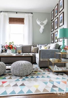 61 Family Friendly Living Room Interior Ideas. I love this geometric rug and the pops of colour, particularly the lamp.