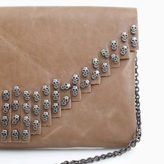 Skull Fringe Clutch - I'm thinking that at age 57, I should not love this so much! I'm 57 too and I'm with you!