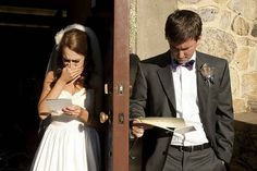 before the ceremony, the bride and groom give each other handwritten letters to read together [between a door].