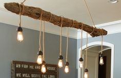 Driftwood hanging light with Edison bulbs.