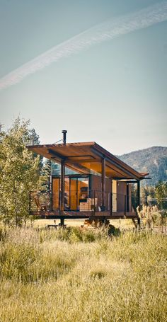 """The steel-clad Rolling Huts designed by Olson Kundig Architects in Manzama, Washington, sit lightly on the land thanks to wheels that allow the tiny residences to """"hover"""" above the site, optimizing views of the landscape. Photo by Derek Pirozzi. Container Home Designs, Container Homes, Architecture Design, Residential Architecture, Landscape Architecture, Casas Containers, Cabins In The Woods, Cabana, Tiny House"""