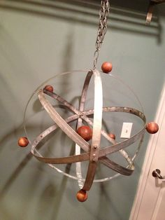A client doing a rustic science themed nursery wanted a mobile that looked like a rustic atom.    The nucleus is an old wood croquet ball and the protons/electrons are wood balls I imbedded a magnet in the small wood balls so they can be put anywhere on the rings.  Science is FUN!