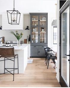 This photo from really showcases the kitchen hutch. Adding in the deep grey really breaks up the mainly white palette through the kitchen and the wood inlay warms things up and ties back into the floors. It's nearly 10 feet tall - I'm on the sear Farmhouse Style Kitchen, Modern Farmhouse Kitchens, Home Kitchens, Farmhouse Decor, Farmhouse Lighting, French Farmhouse, Kitchen Interior, New Kitchen, Kitchen Hutch