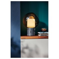 Genuine materials like glass and brass, together with timeless Scandinavian design.