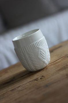 cast porcelain cup with knitted cozy