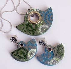 by Meri M. - like the use of rivets in the pendant openings