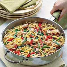 Easy Pasta Recipes: Cajun Chicken Pasta | Sautéed bell peppers, mushrooms, and green onion mix with Cajun-seasoned chicken and a simple white sauce for skillet meal that is sure to please at your dinner table. | #Recipes | SouthernLiving.com
