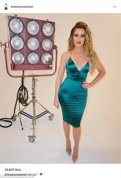 Going green: Khloe Kardashianshowed off her fantastic figure in a clinging jade number in some behind-the-scenes photoshoot pictures posted on her Instagram on Wednesday