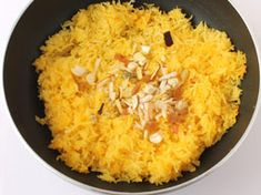 Basmati rice and sugar syrup are the basic ingredients for Meethe Chawal but it is the carefully chosen assortment of Indian spices like green cardamom, cloves, cinnamon and kesar that makes it flavorful and aromatic. With this recipe's tastefully balanced ingredients, step-wise photos and tips and serving ideas, making this traditional Punjabi sweet yellow rice is child's play; even for those who are learning to cook.