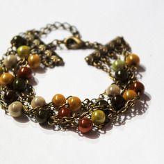 Bracelet couleurs d'automne 5 rangs perles magiques