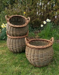 Small & medium sized curved log baskets by John Cowan Baskets