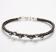 Woven whip bracelet with silver beads