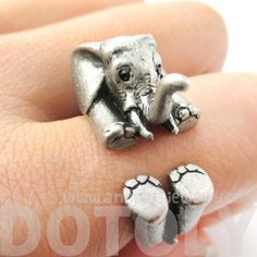 - Details - Sizing An animal inspired ring made in the shape of a baby elephant! Imagine seeing a baby elephant staring up at you every time you glance down at your finger! This super cute ring will m