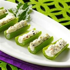 Olive-Stuffed Celery Recipe -My grandmother taught both me and my mom this appetizer recipes. We always serve at Christmas and Thanksgiving. The stuffing is so yummy that even if you don't normally care for the ingredients on their own, you'll love the end result.—Stacy Powell, Santa Fe, Texas