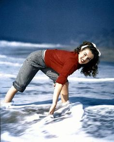 Norma Jeane Dougherty, 1945    Hopefull and beginning model Norma Jeane dougherty, posing in the sea, for photographer Andre DeDienes.