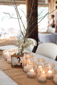 DIY Centerpieces:  We used burlap for our table runners and weighted them down with mason jars partially filled with beach sand.  Each mason jar had a tea light in it to add a little light at each table