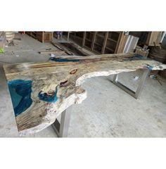 Are you looking for something truly BEAUTIFUL and UNIQUE - a true WORK OF ART? Live Edge Resin Wood Dining Table, one of two produced.