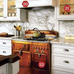 A 1950s copper-colored Chambers range adds timeless elegance. Look for your own vintage stove in the Appliance Club's classifieds. | Photo: Dominique Vorillon | thisoldhouse.com