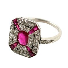 Art Deco Ruby and Diamond Ring    1920s  The octagonal ring set in the center with an oval ruby within a border of single-cut diamonds and calibre' cut rubies. ring size 5 3/4.