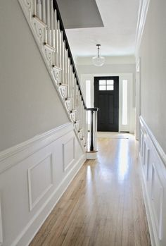 hallway flooring Hallway with light hardwood floors, black front door, and black handrail Grey And White Hallway, Grey Walls White Trim, Black Hallway, Front Hallway, Gray Walls, Modern Hallway, Upstairs Hallway, Modern Staircase, White Oak